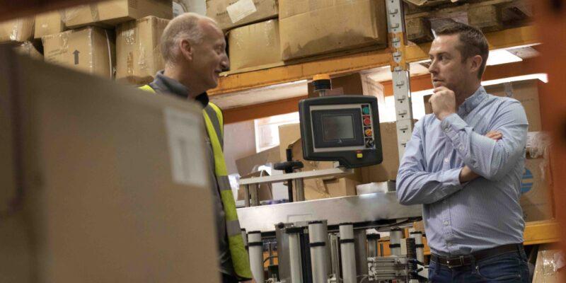 Luke talking in the warehouse